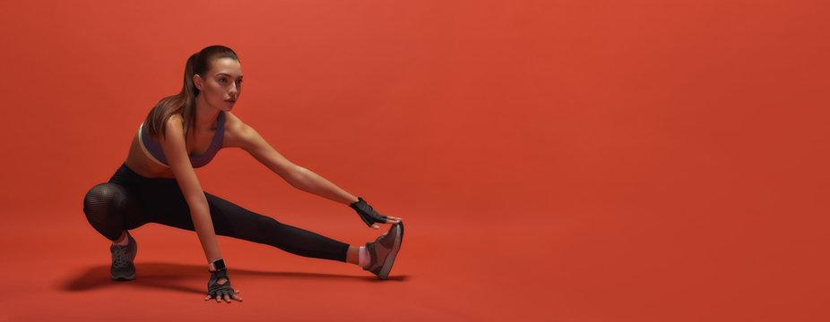 Body of stamina strength. Sportswoman having work out