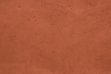 Full frame image of textured stucco in bright terracotta color. High resolution texture of plaster for 3d models, background, pattern, poster, collage, gift wrap, wallpaper etc.