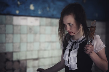 Girl from horror movie with knife Wall mural