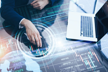Wall Mural - Businessman is analysing financial strategy on a screen of modern hi tech digital tablet. Male hands with futuristic device. Broker at work