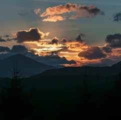 An autumnal square format sunset from the A87 viewpoint looking down Glen Garry, lochaber, Scotland.