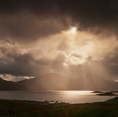 Looking Towards Sgurr Mor and Sgurr an Fhuarain across Loch Quoich through the rain and crepuscular rays