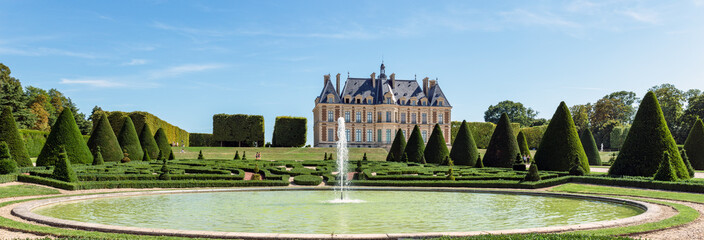 Panoramic view of Parc and chateau de Sceaux with a fountain in foreground - Hauts-de-Seine, France.
