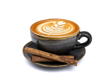 Side view of hot latte coffee with latte art and cinnamon sticks in a vintage matt black cup and saucer isolated on white background with clipping path inside. Image stacking techniques.