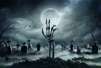 Skeleton Zombie Hand Rising Out Of A GraveYard - Halloween Wall mural