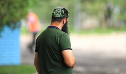 muslim man walks in the park