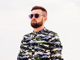 Handsome man traveling in the desert. Man in sunglasses