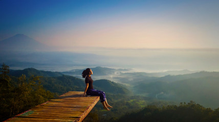 Foto auf Acrylglas Rosa dunkel Young woman enjoying misty morning at Ngisis hill