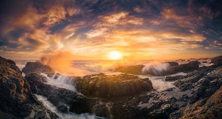 The wave splashes and coastal sunset of Oregon