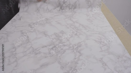 Wall mural Making marble board with adhesive paper for food photography.