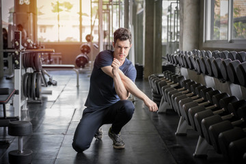 Handsome man exercise workout in gym fitness breaking relax and warm up with dumbbell for bodybuilding