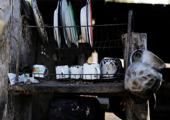 Kitchenware is seen in a ranch in the areas where wildfires have destroyed hectares of forest in Suarez Arana, Charagua