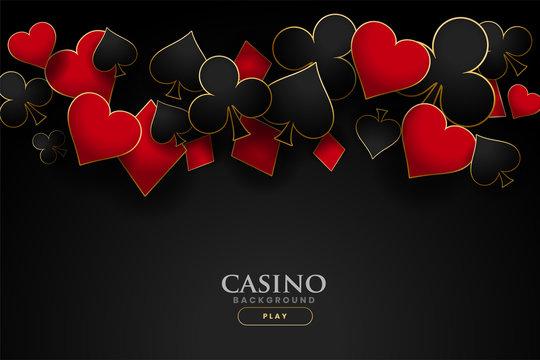 casino playing card symbols on black background