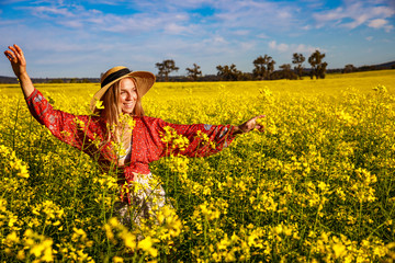 Smiling Young Woman in Flowering Canola Field in Western Australia