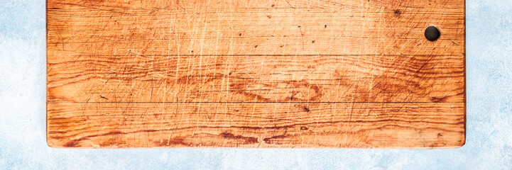Old Chopping Board on  Blue Background