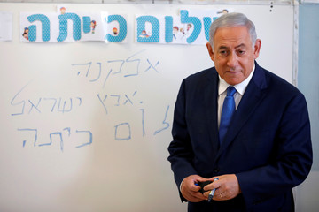 Israeli Prime Minister Benjamin Netanyahu speaks to students during a ceremony opening the school year in the Jewish settlement of Elkana in the Israeli-occupied West Bank