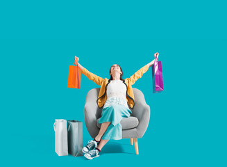 Wall Mural - Cheerful shopaholic woman with shopping bags