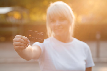 Closeup shot of a woman holding a credit card, Online shopping traveling around the wolrd
