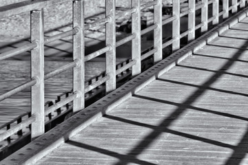 A close up of a bridge with shadow in black and white