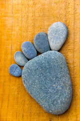 Blue stone foot on wooden background