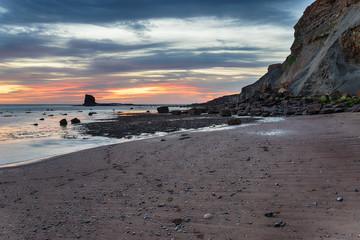 Fototapete - Sunrise at Saltwick Bay on the North Yorkshire coast