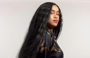 gorgeous mixed race model in studido shoot with long wavy wig on