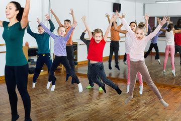 Children dancing contemp in studio smiling and having fun