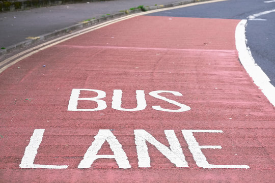 Bus lane sign text on road asphalt