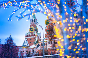 Foto op Aluminium Moskou Christmas Moscow. Russia. Spasskaya tower. St. Basil's Cathedral. Panorama of Moscow. Illumination against the backdrop of the Kremlin. Christmas decorations on the streets of Moscow. New Year