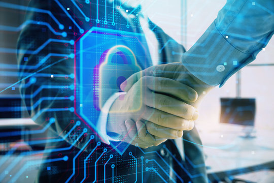 Double exposure of lock icon hologram on office background with two men handshake. Concept of data safety