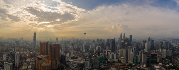 Aerial panorama of Kuala Lumpur city skyline during cloudy day, Malaysia