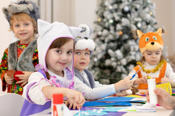 Group of funny kids prepare to x-mas holiday. Children weared animal costumes