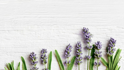 Tuinposter Lavendel Lavender flowers on white wooden background