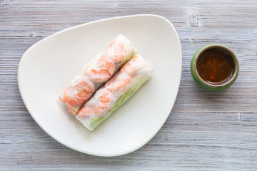 top view of Nem cuon rolls on plate on table