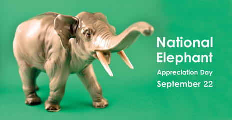 National Elephant Appreciation Day illustration. Realistic elephant statue stock images. Figurine elephant stock images. Elephant isolated on a green background. Important day