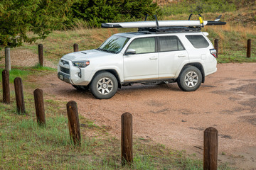Toyota 4runner SUV with a stand up paddleboard
