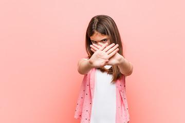 Cute little girl doing a denial gesture Wall mural
