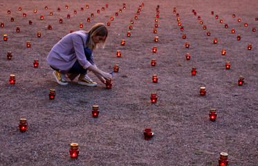 A woman attends a memorial ceremony marking the anniversary of the school siege in Beslan