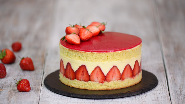 Sponge cake with strawberries and vanilla cream. Strawberry Fraisier cake .