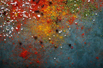 Different spices scattered on the table, red paprika powder, turmeric, salt, cloves, pepper Fototapete