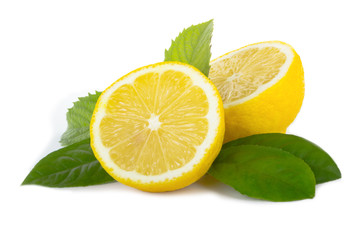 fresh lemons halves with green leaves  isolated on white background