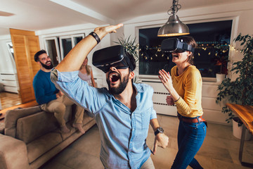Young couple having fun with virtual reality headset glasses - Happy people playing game with new...