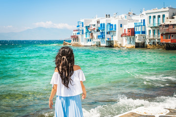 Wall Mural - Young woman on summer vacation in Mykonos, Greece.