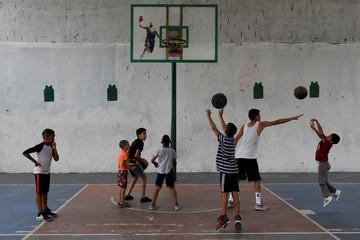 Children play basketball in a neighbourhood in Caracas