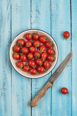ripe cherry tomatoes on a wooden table