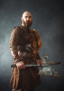 Angry viking with axe, martial spirit, barbarian