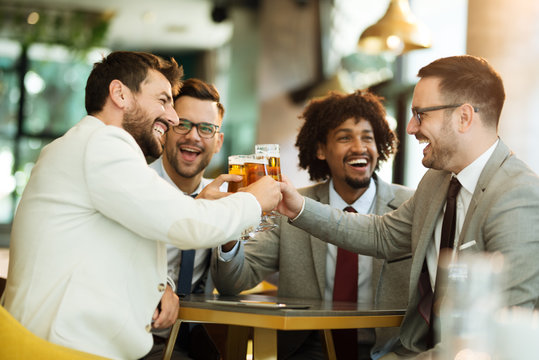 young businessmen after work in a pub