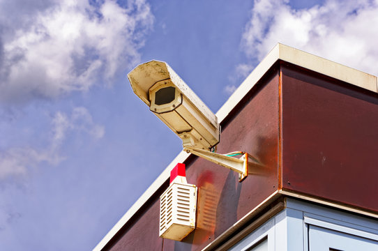 Security camera on a sunny day with alarm