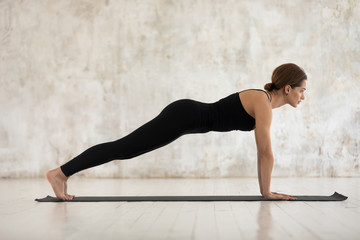 Woman practicing yoga, Plank, Push ups or press ups exercise