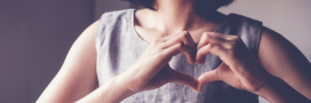 woman making hands in heart shape, heart health insurance, social responsibility, donation charity, world heart day,  appreciation concept, world mental health day